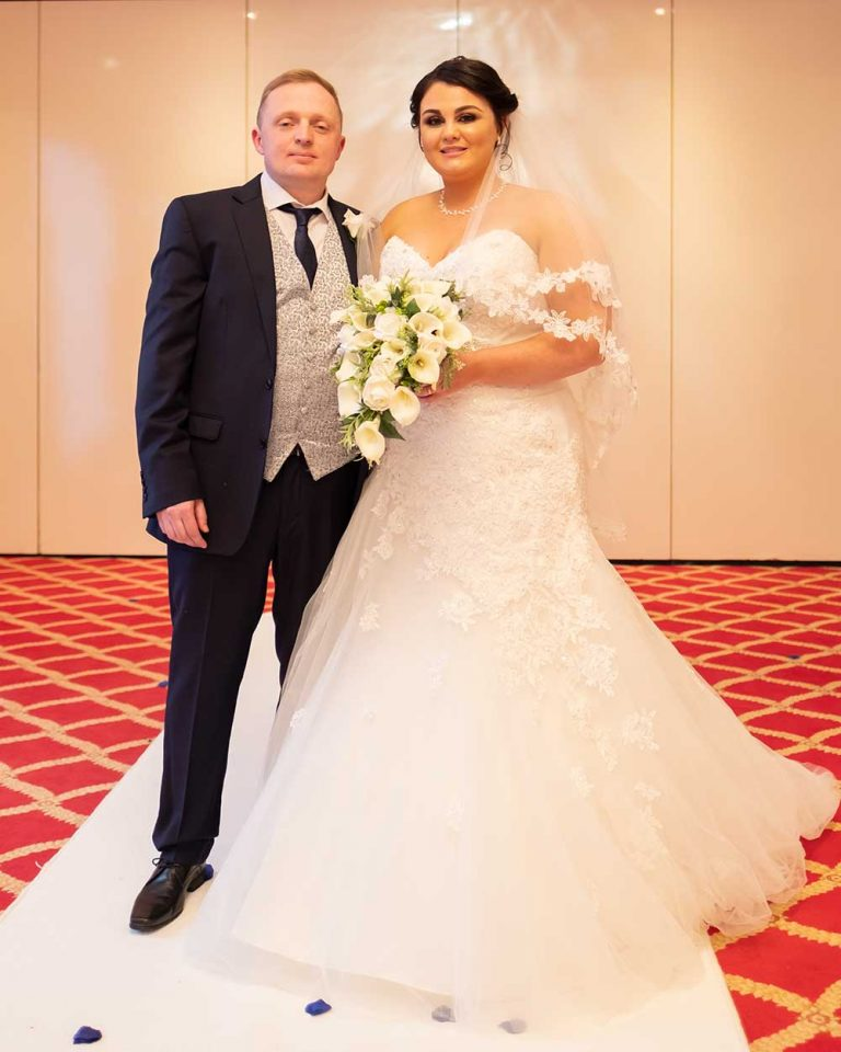 Wedding-bride-holding-flowers-standing-with-groom-Lloyd-Dunkley-Photography-DSCF1043