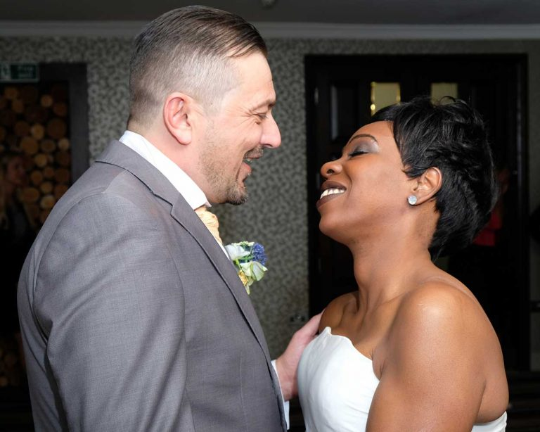 Wedding-bride-and-groom-look-lovingly-at-each-other-Lloyd-Dunkley-Photography-DSCF3687