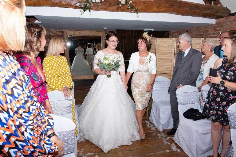 Wedding-bride- and-mother-of-the-bride-walking-down-the-aisle-Lloyd-Dunkley-Photography-DSCF3747